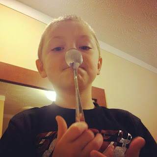 Grandboy holding a spoon on his nose
