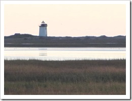 11.2011 sun setting lighthouse west end provincetown