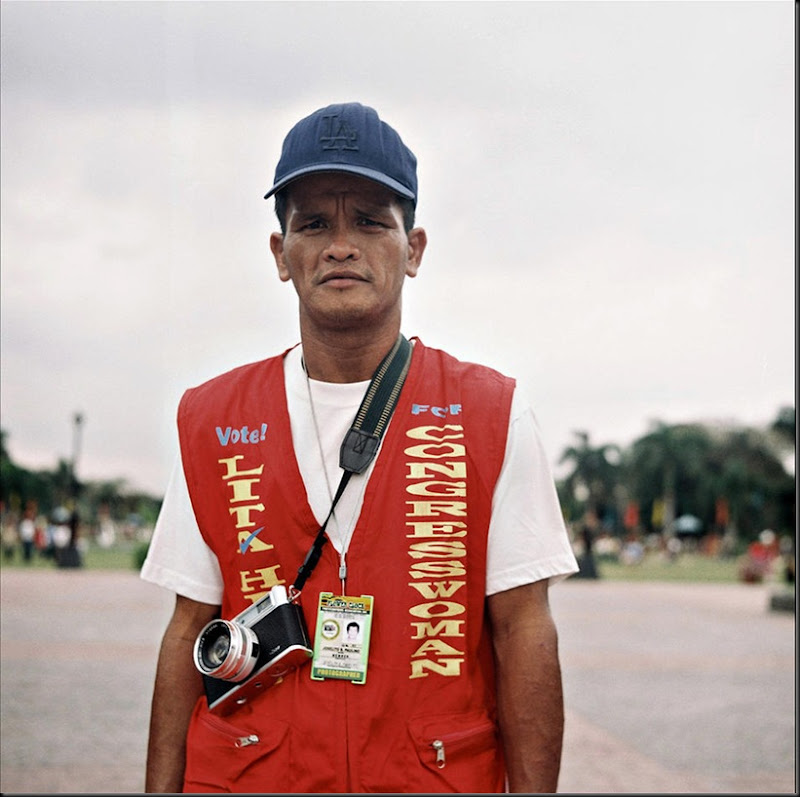 Portrait of a Luneta park photographer offering photo souvenir services to tourists and passersby.
