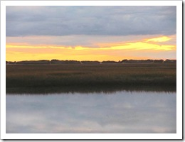 11.2011 sun setting reflection on water west end provincetown
