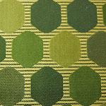 Tkanina ozdobna w geometryczne wzory. Na zasłony, poduszki, narzuty, dekoracje. Zielona.