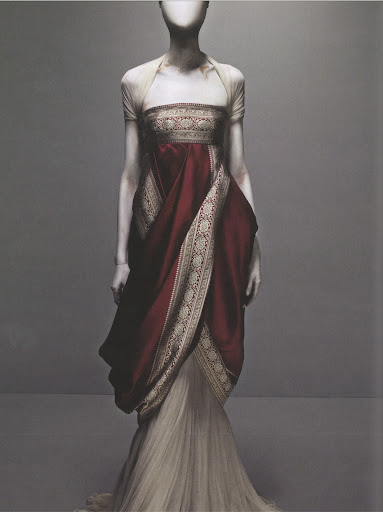 While working, McQueen liked to recall the styles and personas of great women of the past–Catherine the Great and Marie Antoinette, for example. This dress embodies the power and elegance of those iconic figures.