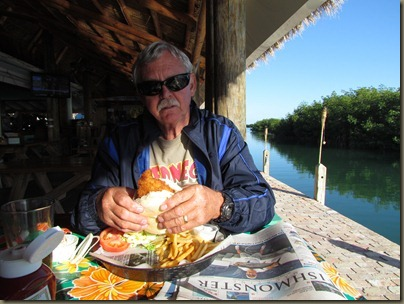 al eating hogfish sandwich at geiger key restaurant and rv park