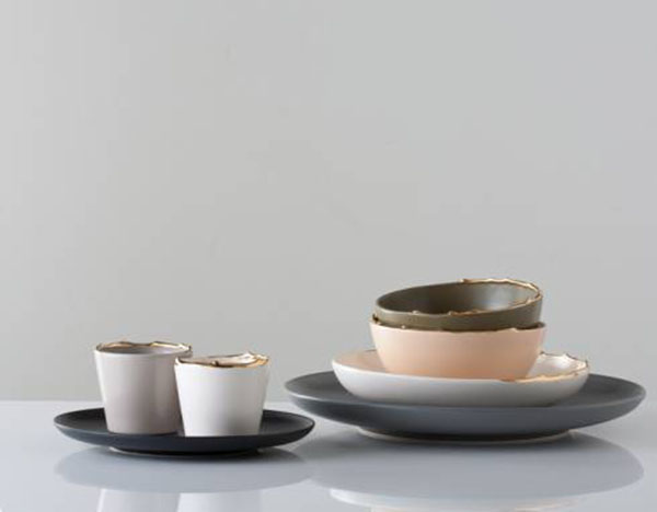 Flawed gold plated set of bowls  1