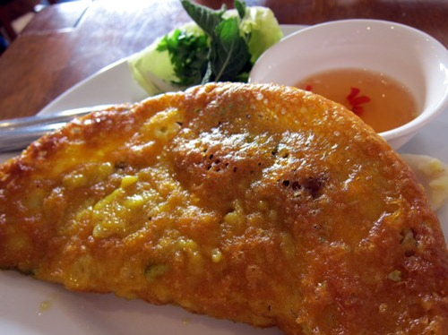 Bánh xèo – golden pancake stuffed with bean sprouts, prawns and pork