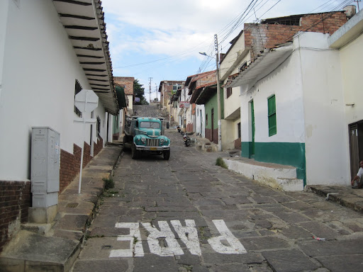 An old truck on steep streets in San Gil, Colombia