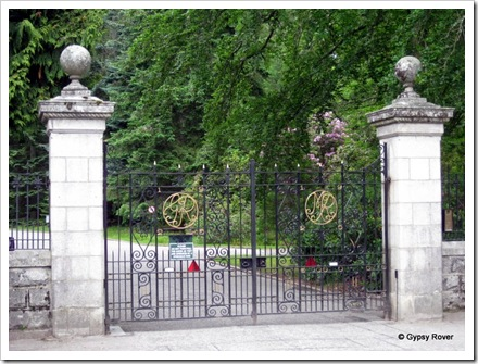 Entrance gates inscribed with Queen Mary and King George. Balmoral Castle.
