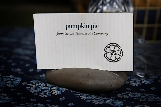 Each pie on the dessert bar had a label propped up in a stone.
