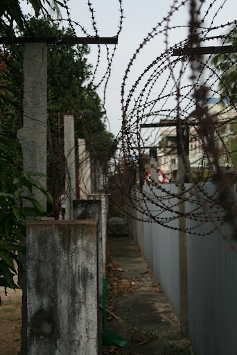 The barbed walls of S-21 detention centre, or Toul Sleng.