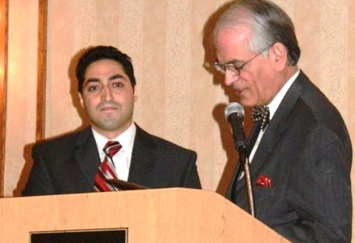Mohammad Muhsin Chisti accepts Austin-Flint's Best Outgoing Resident Award and the Program Director's Award at the 2010 Research Symposium; he also won first prize in research