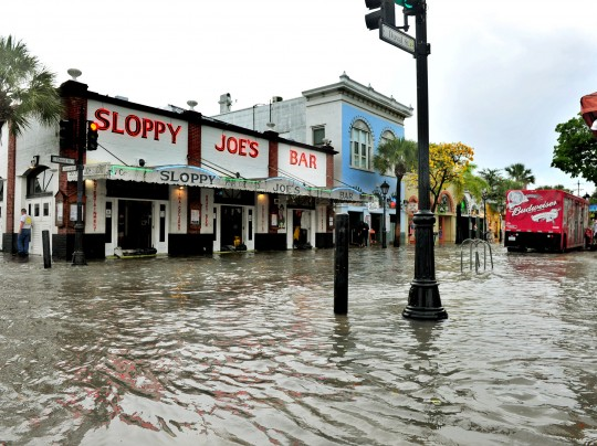 This Thursday, 2 May 2013 photo shows flooding on Duval Street in Key West, Florida, after roughly five inches of rainfall. In many sea level projections for the coming century, the Keys, Miami, and much of southern Florida partially sink beneath potential waves. Photo: Rob O'Neal / The Key West Citizen / Associated Press