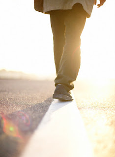 Man Walking Along Line in Road --- Image by © Bloomimage/Corbis