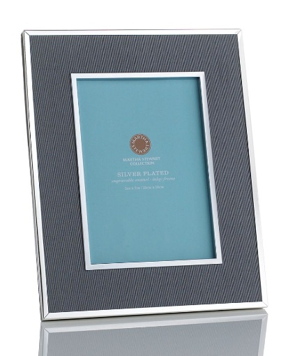 Make your neighbor's house a home with this ribbon trimmed frame. You can even offer to take a picture of them outside their new home to put in the frame. (macys.com)
