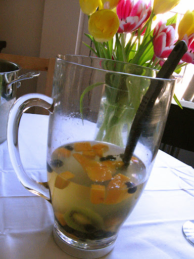 Prosecco punch with mangoes, blueberries, and kiwi.