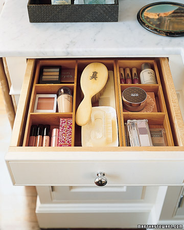 Wooden boxes and trays help categorize the items and are available in various sizes and materials, so they can be mixed and matched to fit any sort of drawer.