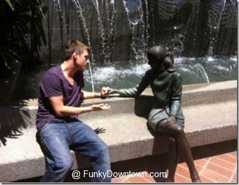 funny-lonely-man-talks-to-statue