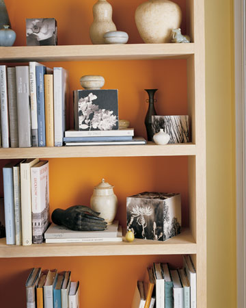 Fall: Paint the backs of bookcases in a bright orange for the fall season -- or just line them with colored paper -- to give your case a cozy touch.