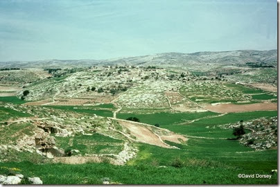 1 View of Kh el Qom from W--view E, with caves on left dd
