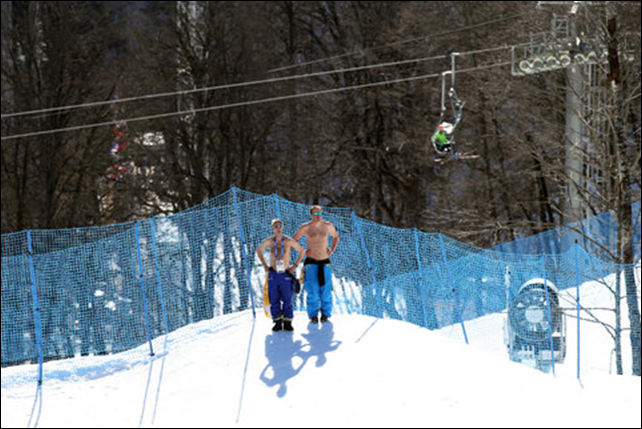 Workers at the Rosa Khutor Extreme Park at the Winter Olympics in Sochi, Russia, catching some sun on Thursday, 13 February 2014. Photo: Josh Haner / The New York Times