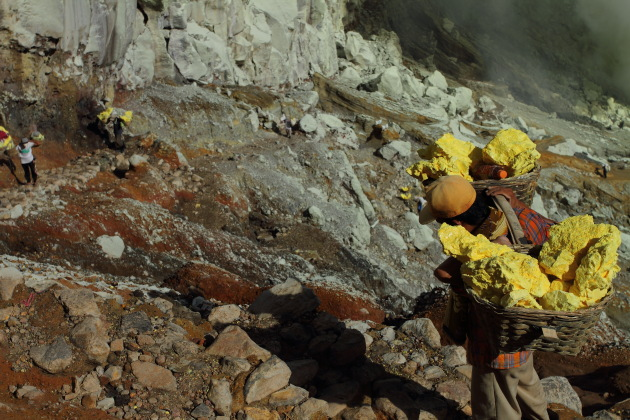 Carrying a heavy sulphur load in hellish conditions at Kawah Ijen, Indonesia
