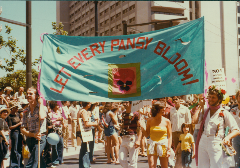 """Let Every Pansy Bloom"" banner at the San Francisco Gay Freedom Day pride parade. June 25, 1978."
