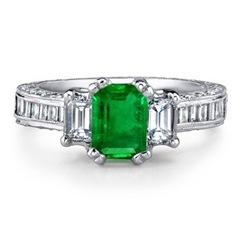Emerald Cut Emerald and Diamond Three Stone Ring in Platinum
