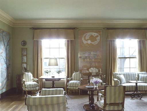 Receiving soft morning light, this welcoming space in Rheinstein's 1914 Georgian-Revival home, is used specifically as a party room.  The painting is a Charles Garabedian collage and the bust is from the 18th century.
