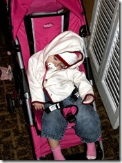 Elaine 11 months asleep in stroller