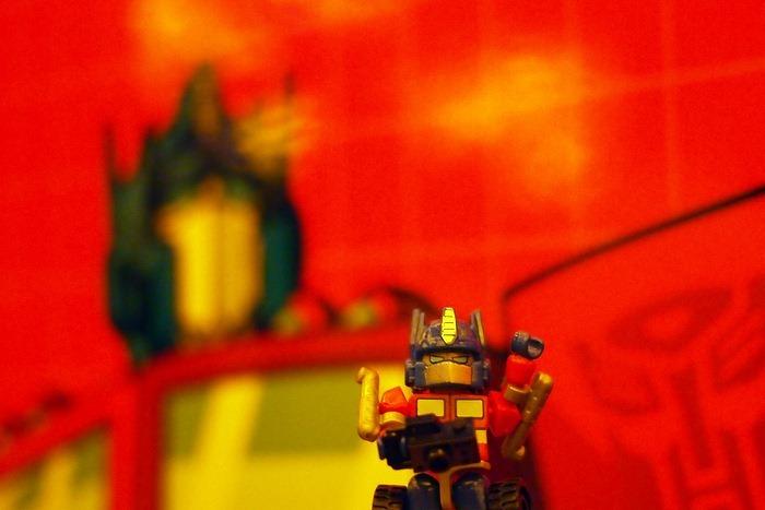 Optimus Prime Kreon in front of G1 Optimus Prime