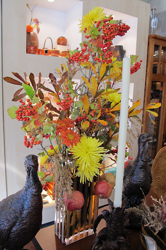 The autumn colors in this arrangement are inspiring me.