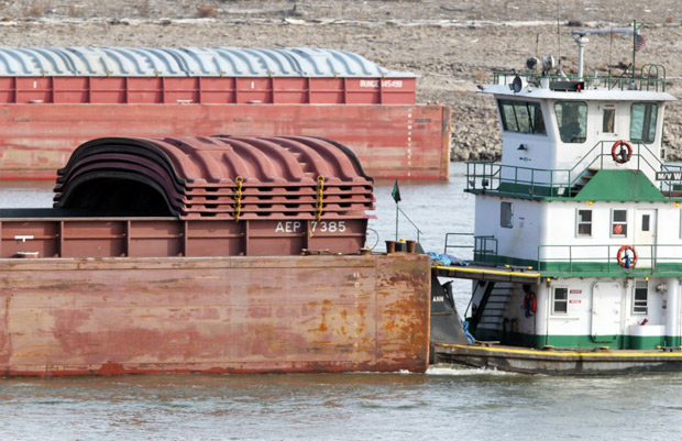 A barge moves through the shrunken Mississippi River. The Mississippi River's level dropped to historic lows in 2012, and barge industry trade groups warned that river commerce could essentially come to a halt in an area south of St. Louis. Photo: Derik Holtmann / Belleville News-Democrat / AP photo