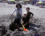 Matthew, Eidan, and Kai digging at the beach