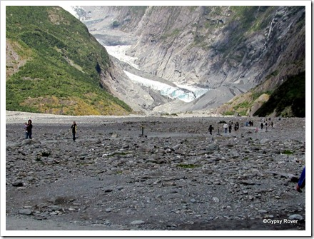 Like little ants people traipsing 2 kilometres across the valley floor to get to the Franz Josef glacier.