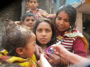 Village Women child being vaccinised