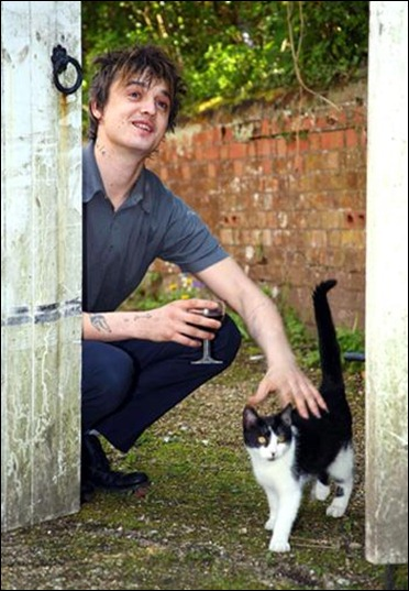 Pete Doherty, the troubled rocker from The Libertines and Babyshambles, pets his cat Jimmy and sips wine outside his home in Wiltshire