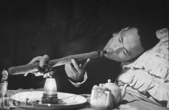 a smoker in a den in China in 1946.jpg