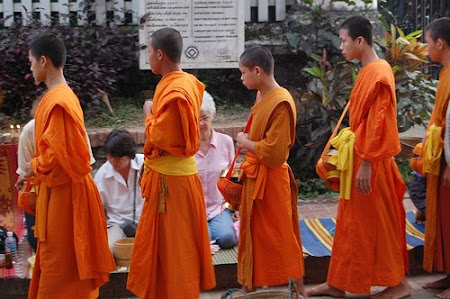 Laos: Monks receiving alms Laos