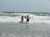 Splashing in the waves with mommy and daddy. (July)