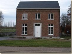 Halmaal, Halmaalweg: voormalige pastorie? Op de steen midden bovenaan leest men WG 1859