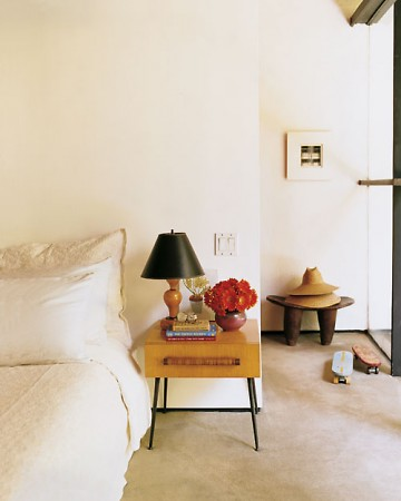 The white-and-grey color palette of this room is like a canvas—the owner's belongings are like little pops of color.