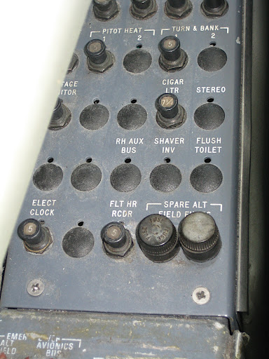 I saw this control panel to one side of the pilot. I find a few of these buttons quite interesting: cigar ltr, stereo, and flush toilet?