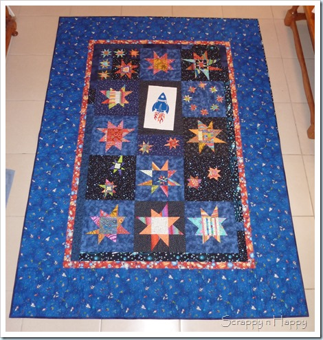 Scrappy n 39 happy wonky star space quilt for Spaceship quilt
