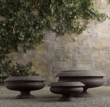 I imagine these planters with vines spilling over the sides. It's a very dramatic look. (restorationhardware.com)