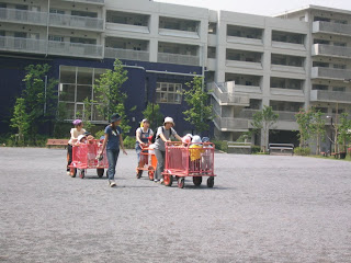 The kids at the local daycare in Minato getting carted out for playtime