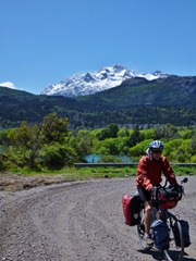 Riding towards Chile with Parque Nacional Los Alerces in the background.