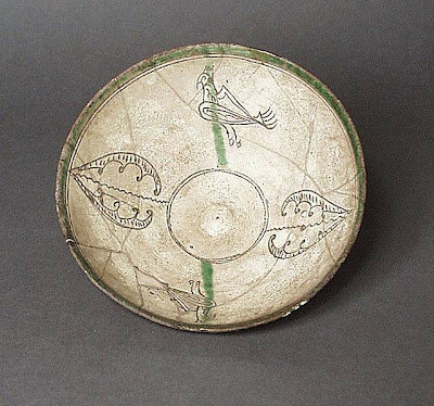 Bowl Iran Bowl, 11th century Ceramic; Vessel, Earthenware, incised, color under transparent glaze, 2 3/4 x 7 in. (6.99 x 17.78 cm) The Nasli M. Heeramaneck Collection, gift of Joan Palevsky (M.73.5.132) Art of the Middle East: Islamic Department.