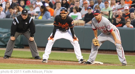 'Baltimore Orioles right fielder Nick Markakis (21) and Washington Nationals first baseman Adam LaRoche (25)' photo (c) 2011, Keith Allison - license: http://creativecommons.org/licenses/by-sa/2.0/