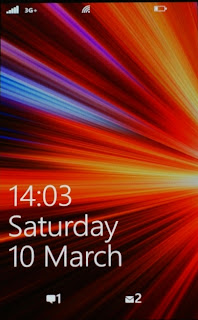 The lock screen slides up to reveal the home screen or the unlocking keypad in case you have set to password lock the phone. This dual lock (slide and password) is implemented a lot better in WP7 than in iOS which is just a disconnected experience
