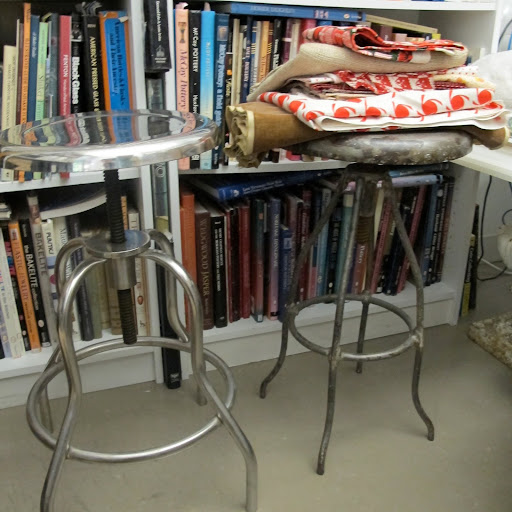 Vintage stools with a small footprint provide extra seating and serve as a good place to rest fabric samples, when not in use.