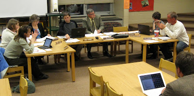 Washington School Board members sat on small chairs in Stewart Elementary's Media Center for their meeting Wednesday